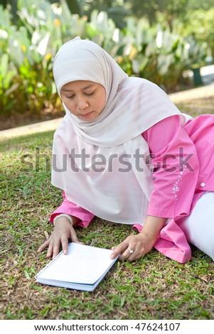 stock photo beautiful mature muslim woman enjoying the park with a book 47624107 Gattina— nude italian girl lying sideways rear shot
