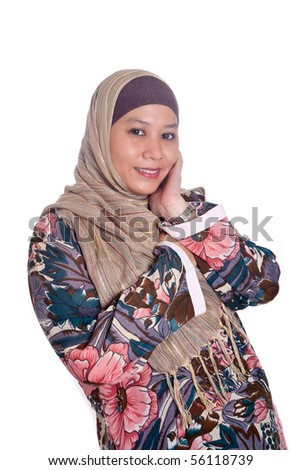 stock photo beautiful mature muslim woman in scarf 56118739 stock photo : Beautiful mature Muslim woman in scarf. Save to a lightbox ▼