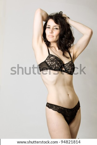stock photo : Beautiful mature woman in lingerie posing in studio
