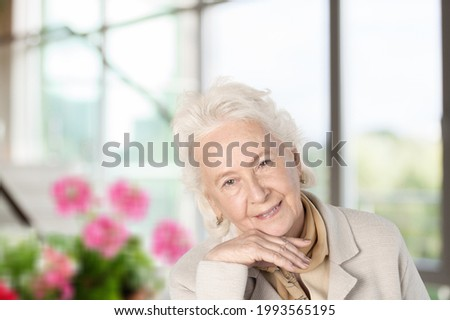 Beautiful mature woman posing at home