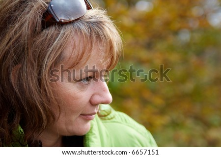 stock photo : Beautiful mature women in a autumnal scenery