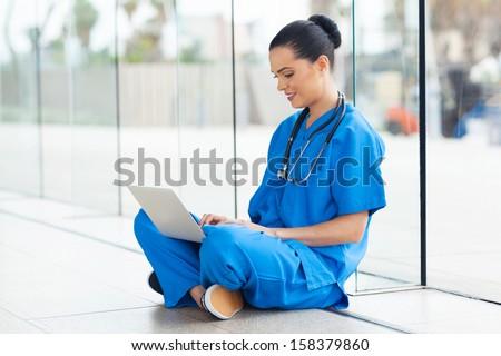 beautiful medical nurse working on laptop