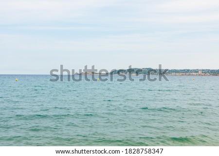 Beautiful mediterranean sea landscape. Mona del Cap Prim, Cap de Marti in the background. Xavia/Javea, Alicante province, Valencian community, Spain. Paradise atmosphere. Stock foto ©