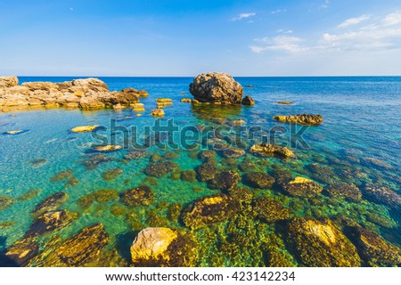 Beautiful mediterranean seaside landscape with yellow rocks and azure blue water background image