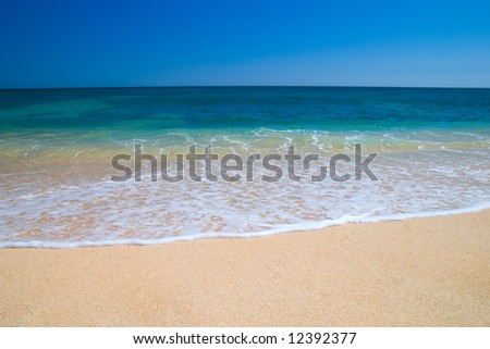 Beautiful meditteranean beach with gently breaking wave