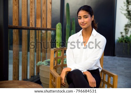 Beautiful mental and social therapist sitting relaxed and dignified in retreat center