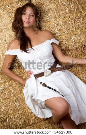 Beautiful mexican country girl in hay