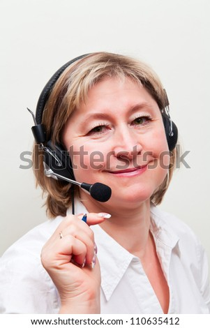 Beautiful middle age blond woman in call center