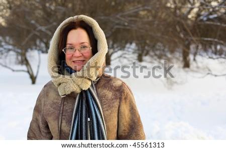 Beautiful middle aged woman enjoying winter day - stock photo