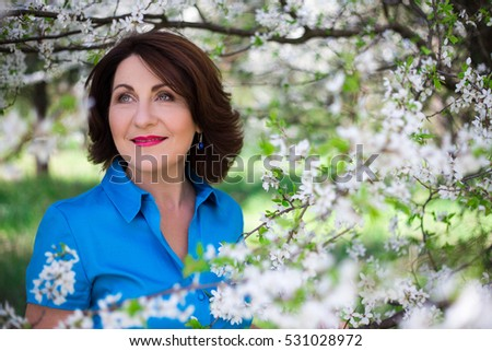 beautiful middle aged woman in...