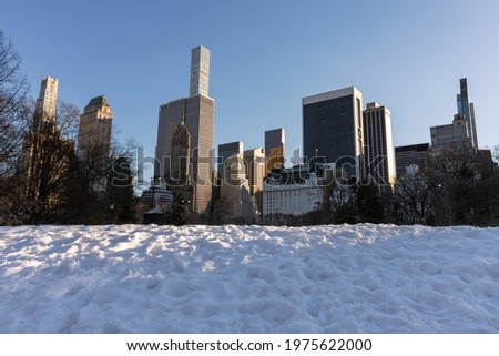 Beautiful Midtown Manhattan Winter Skyline with Snow seen from Central Park in New York City Stock photo ©
