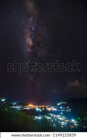 Beautiful milky way over the skies with a view of a city at night #1149225839
