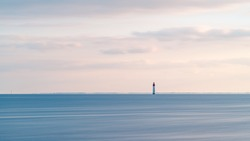 Beautiful minimalist seascape at sunset with Chauveau lighthouse. Rivedoux, Re Island, France
