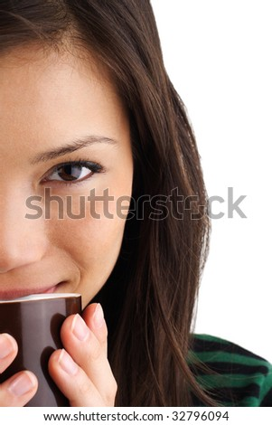 Beautiful mixed asian / caucasian woman drinking coffee or tea