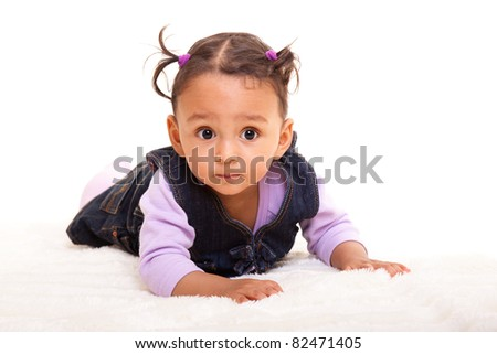 Beautiful mixed race baby lying on the floor