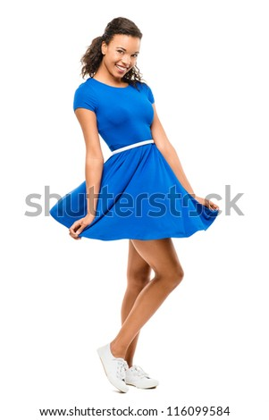 Beautiful mixed race woman dancing sexy blue dress isolated on white background