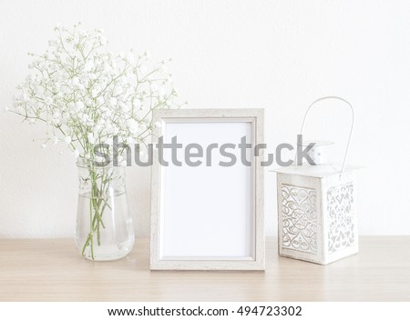 Beautiful Mockup With White Frame, White Baby's Breath Flowers And White Candle Holder #494723302