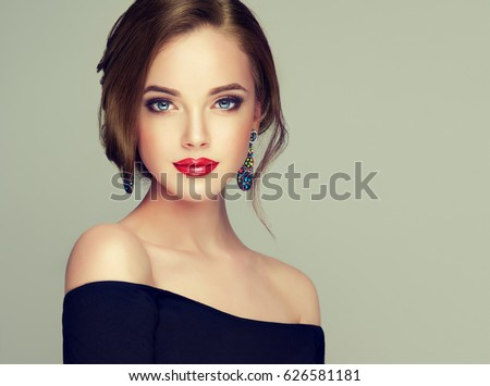 Beautiful model girl  with elegant hairstyle . Woman with fashion style makeup - Shutterstock ID 626581181