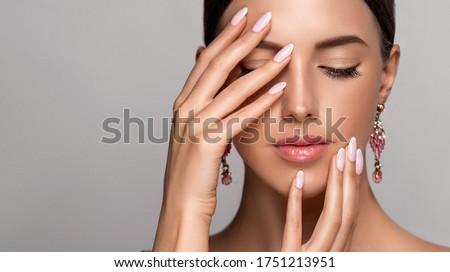 Beautiful model girl with  french manicure nail , Jewelry, earrings and accessories. Fashion makeup and care for hands , nails and cosmetics .