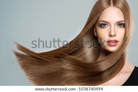 Beautiful model girl with shiny brown and straight long  hair . Keratin  straightening . Treatment, care and spa procedures. Smooth hairstyle #1038740494