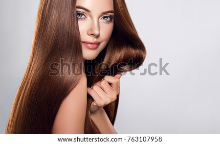 Beautiful model girl with shiny brown and straight long  hair . Keratin  straightening . Treatment, care and spa procedures. Smooth hairstyle  #763107958