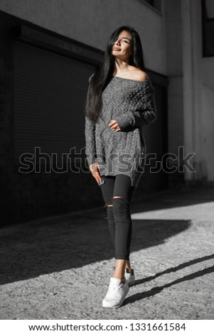 Beautiful model poses for the camera on the streets. #1331661584