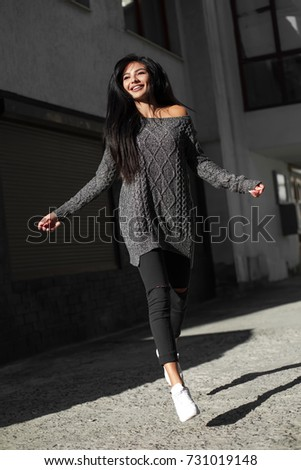 Beautiful model poses for the camera on the streets. #731019148