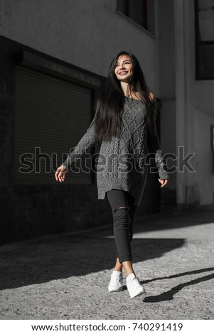 Beautiful model poses for the camera on the streets. #740291419