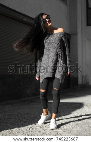 Beautiful model poses for the camera on the streets. #745225687