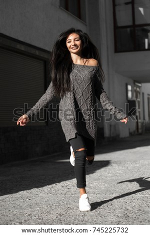 Beautiful model poses for the camera on the streets. #745225732
