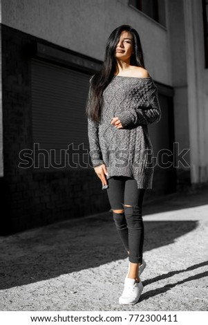 Beautiful model poses for the camera on the streets. #772300411