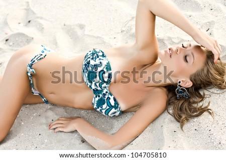 Beautiful model posing fashion on a beach