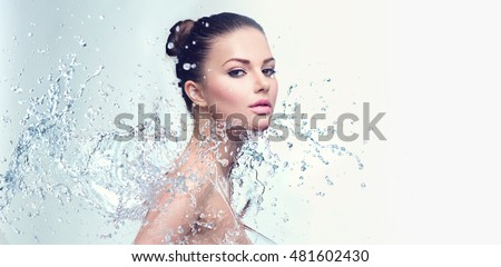 Beautiful Model Spa Woman with splashes of water. Beautiful Smiling girl under splash of water with fresh skin over blue background. Skin care, Cleansing and moisturizing concept. Beauty face - Shutterstock ID 481602430