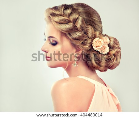 Beautiful model with elegant hairstyle . Beautiful woman with fashion wedding hair and colourful makeup