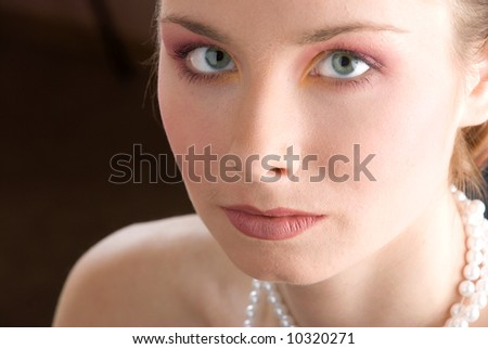 Beautiful model with green eyes looking into the camera