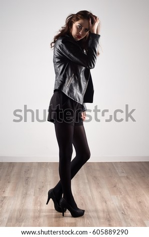 Beautiful model woman with leather jacket #605889290