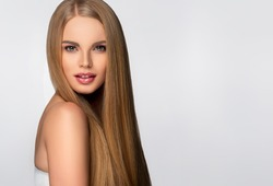 Beautiful model woman with shiny  and straight long hair. Keratin  straightening. Treatment, care and spa procedures. Blonde beauty  girl smooth hairstyle