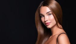 Beautiful model woman with shiny  and straight long hair. Keratin  straightening. Treatment, care and spa procedures. Beauty  girl smooth hairstyle