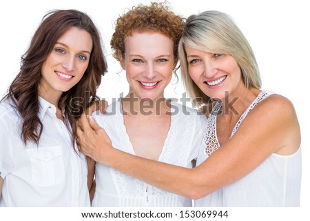 Beautiful models posing hugging each other on white background