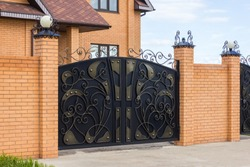 Beautiful modern automatic gates in a private house
