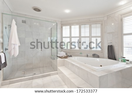 beautiful modern bathroom with marble tiles in australian mansion #172533377