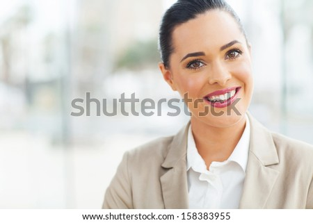 beautiful modern businesswoman in office looking at the camera - stock photo