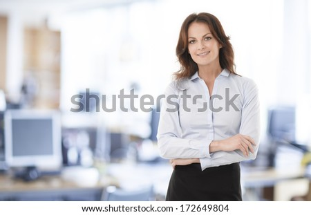 Beautiful modern businesswoman standing in her office. #172649804