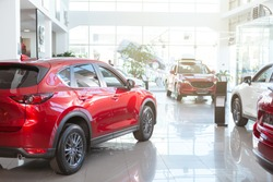Beautiful modern cars on display at local dealership salon. Automobiles for sale, copy s[ace