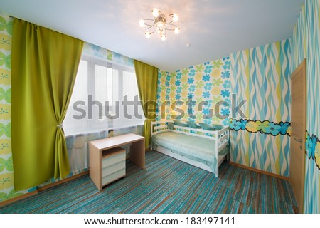 Beautiful modern children bedroom with carpet, curtains and chandelier.
