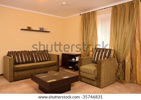 Beautiful Modern Hall With A Sofa, An Armchair, And A Small Little ...