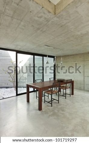beautiful modern house in cement, interior, wooden dining table