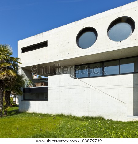 beautiful modern house in cement, outdoor, facade #103879739