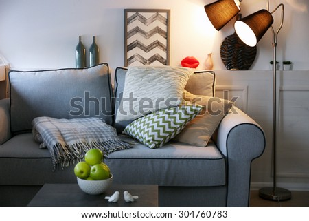 Beautiful modern living room with grey sofa and floor lamp