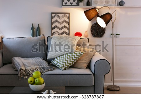 Beautiful modern living room with grey sofa and floor lamp